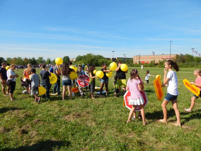 "Children got involved blowing up balloons that said ""LIFE""."