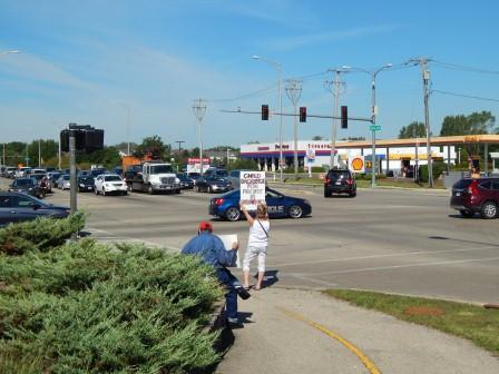 """Child Sacrifice for Profit is Demonic"" Corner of Eola Rd. and E. New York St., Aurora, IL"