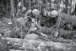 Original Caption: Emergency Transfusion. Dak To, South Vietnam: During a bloody battle, when a soldier is wounded and needs a transfusion, it takes place there on the spot, in the battle zone. Here, a G.I. gets a transfusion near infamous Hill 875, captured by American forces after some of the most violent fighting of the war in Vietnam. North Vietnamese troops poured heavy mortar fire on an artillery base near Dak To and the Special Forces camp in Kontum, 40 miles to the South.
